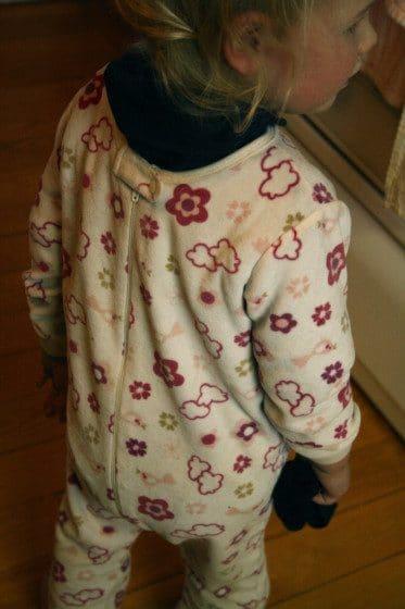 toddler wearing sleeper backwards