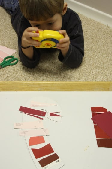 child photographing craft with toy camera