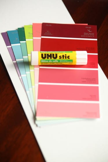 paint chip samples, glue stick, white cardboard