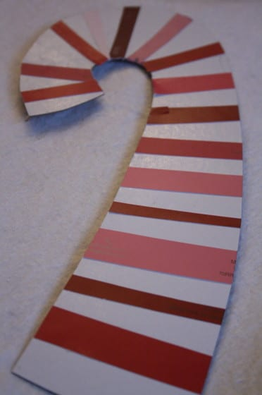 candy cane made from cardboard and red and pink paint chips