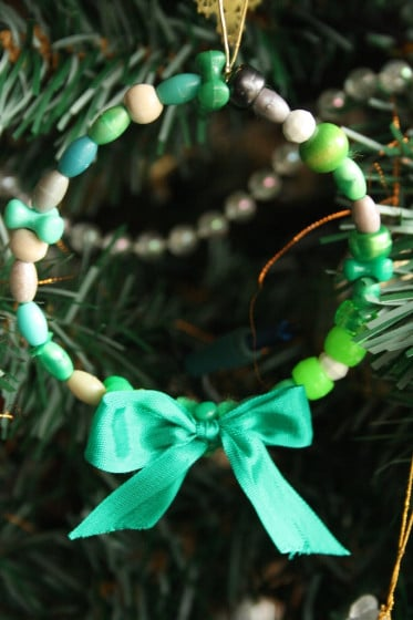 green beaded wreath ornament with green bow