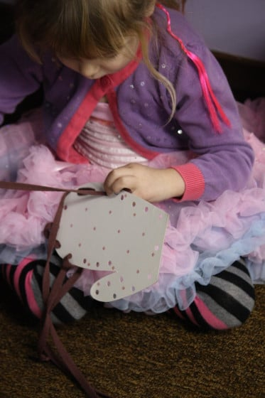 preschooler lacing with mitten lacing card