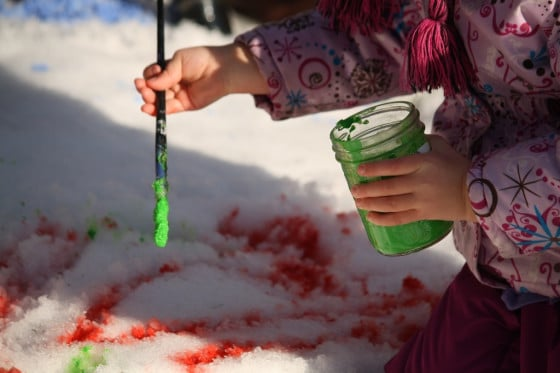 painting the snow with green and red paint