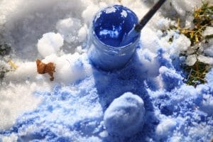 painting the snow with tempera paints