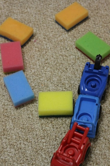 playing with coloured sponges and cars