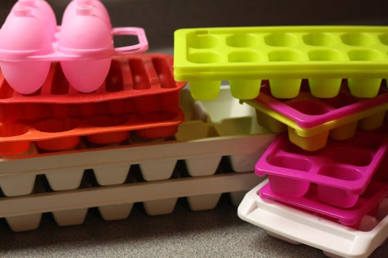 various ice trays and storage containers for making coloured ice cubes