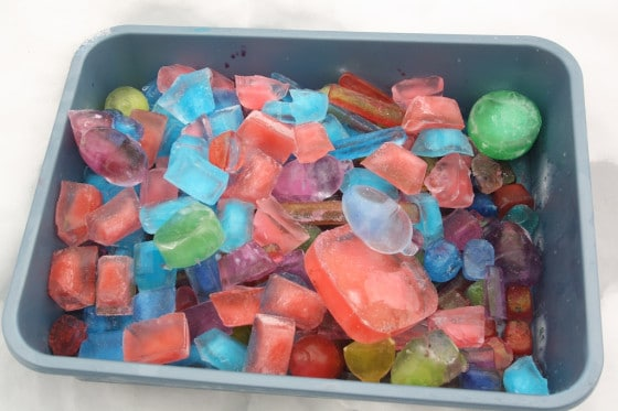 bin of coloured ice cubes