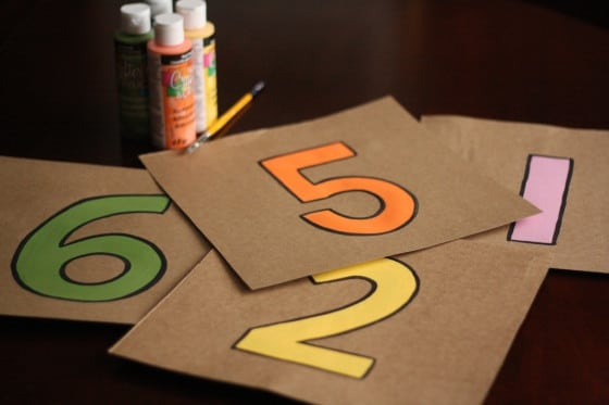 cardboard squares with numbers painted on them