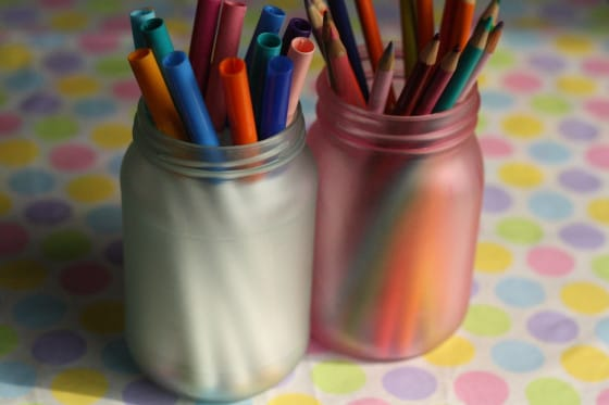 coloured mason jars holding pencils and markers