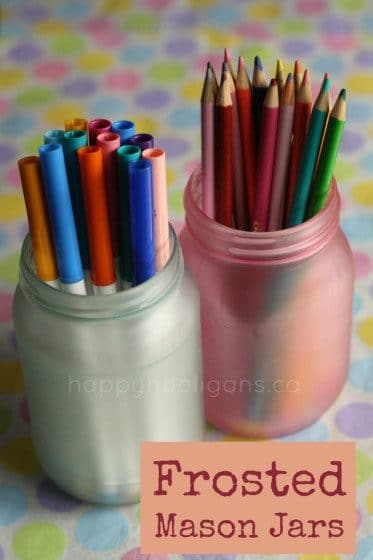 pencils and markers in painted mason jars