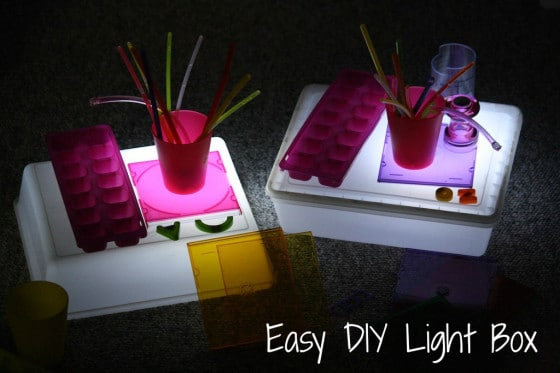 colourful items on homemade light boxes in dark room