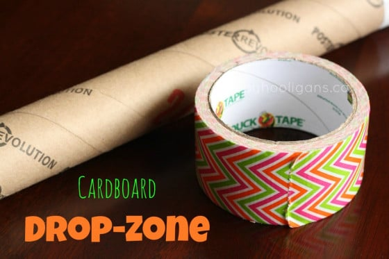cardboard drop zone - a tube and a roll of duck tape