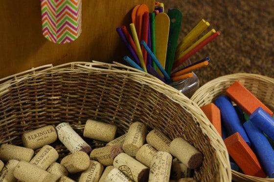wine corks, craft sticks and blocks for cardboard drop zone