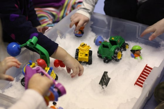 vehicles in a snow sensory bin