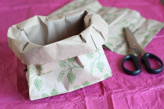 folding down edges of paper bag to make birds nest craft