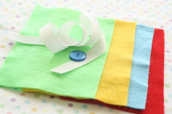coloured felt, ribbon and button for button snake