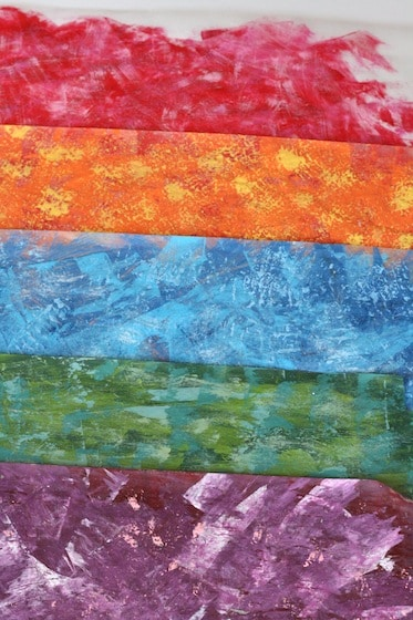 How to paint like Eric Carle with layers of colour on wax paper