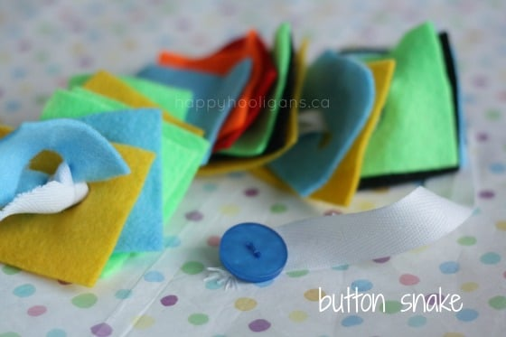 button snake with felt squares on the ribbon