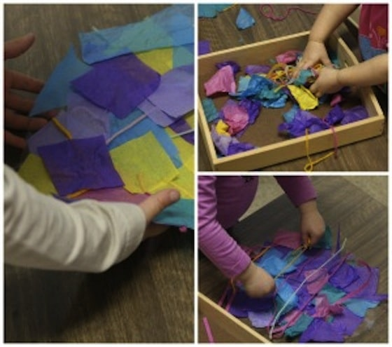 toddlers making easter egg collage with contact paper and tissue paper