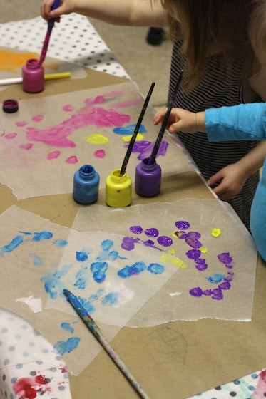 toddlers and preschoolers painting wax paper