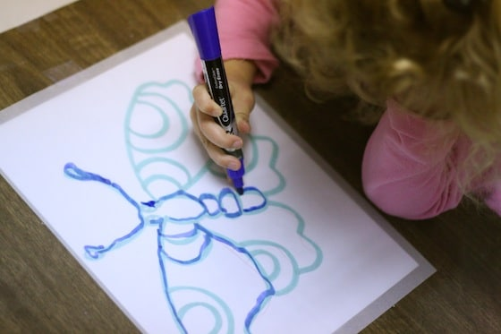 preschooler tracing with tracing paper