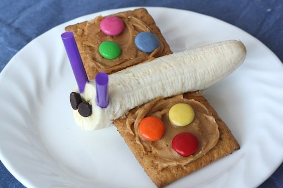 Healthy butterfly shaped snack made with banan , graham crackers and smarties