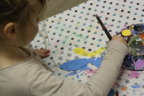 preschooler painting blue fish