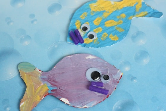 purple fish with purple straw mouth, blue and yellow fish with purple mouth