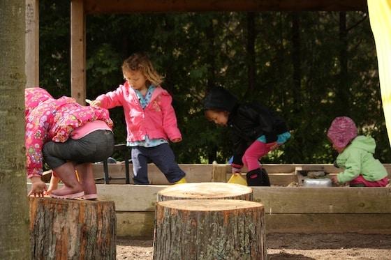 play logs by the sandbox - happy hooligans