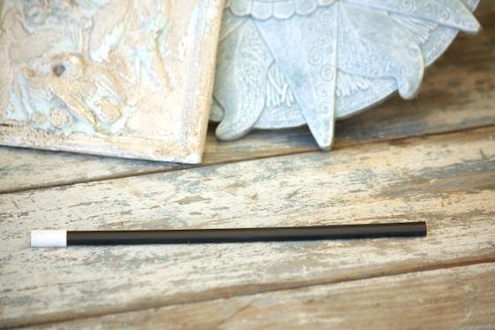 homemade magic wand on bench
