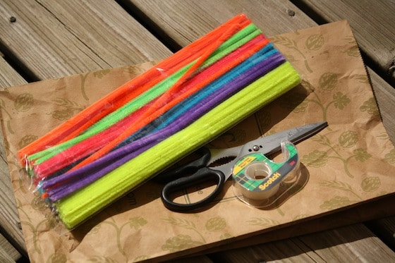 pipe cleaners, paper bag, scissors and tape