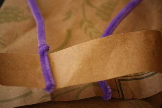 pipe cleaners wrapped around a paper bag strip