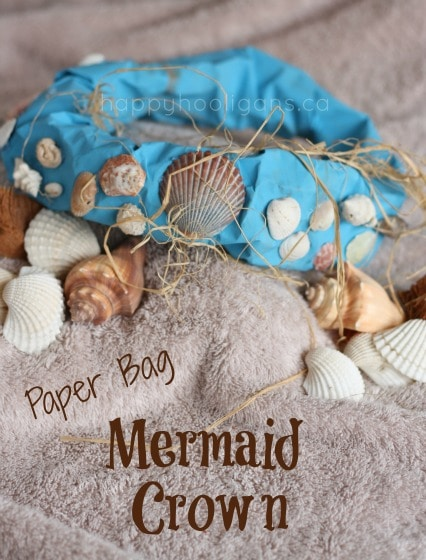 paper bag mermaid crown sitting on a bed of shells