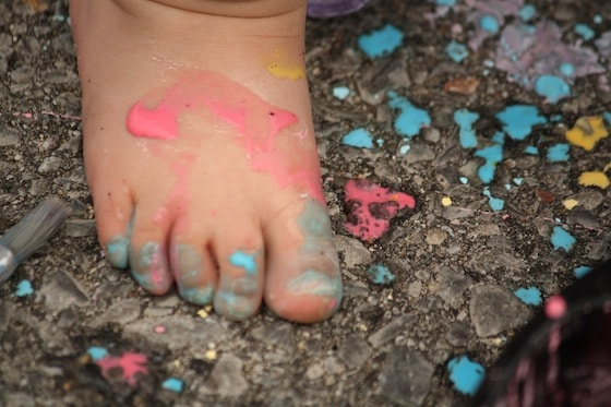 toddlers foot covered in chalk paint