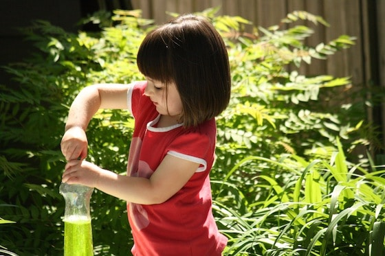 popping top on squeeze bottle - fine motor