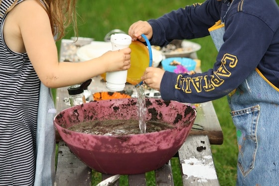 adding water to the mud kitchen