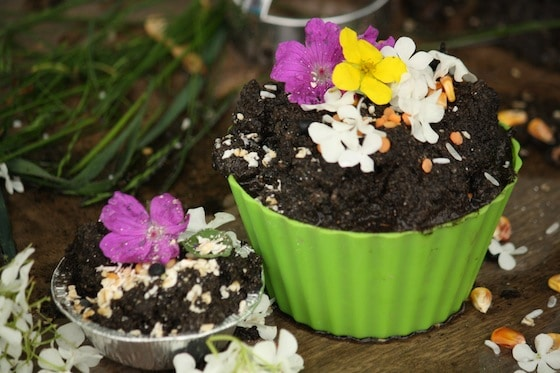 mud pie decorated with flowers, oatmeal and corn kernels