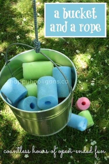 bucket on a rope, filled with pool noodles