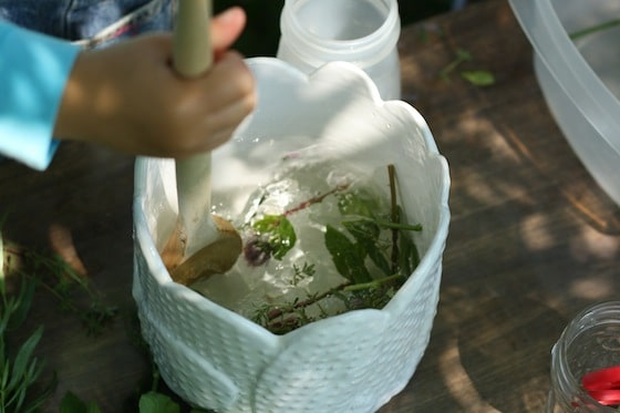 stirring fresh herbs into water activity