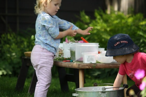 making Sensory Soup with fresh herbs and flowers