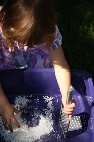 grating the ivory soap to make fairy mud
