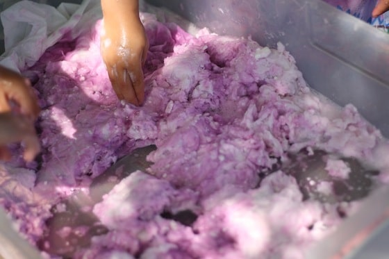 mixing toilet paper and coloured soapy water together to get fairy mud