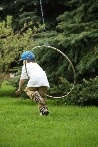 climbing through a hula hoop - gross motor development