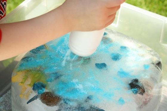 sprinkling blue salt on a block of ice