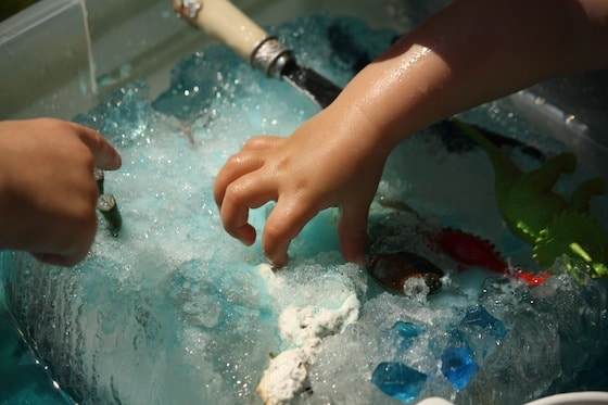 dino dig: science activity. digging toys out of an ice block