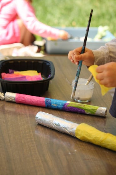 toddlers and preschoolers painting rain sticks
