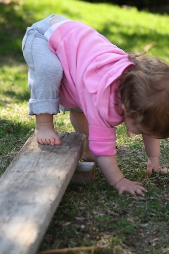 one year old on homemade balance beam