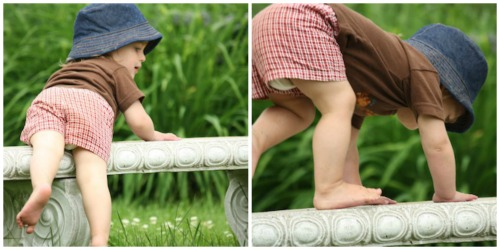 toddler balancing on a garden bench