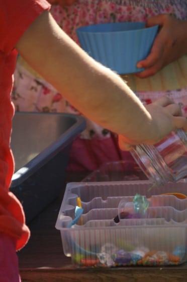 preschoolers playing with i spy sensory bin