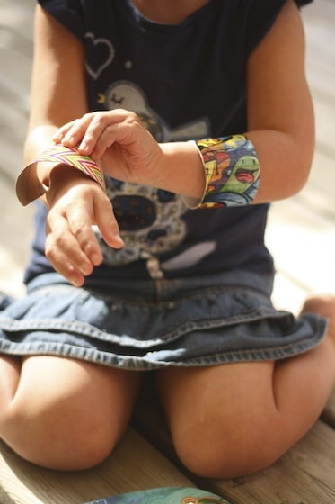 child putting on two duct tape bracelets